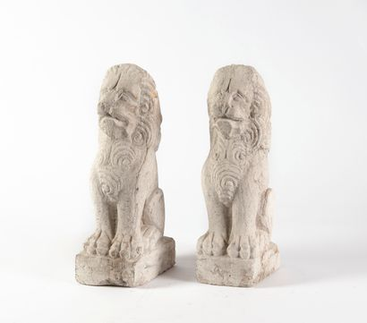 Pair of sitting guardian lions.  Carved soft...