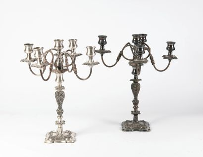 A pair of silver-plated candlesticks consisting...