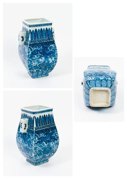 A blue-white porcelain vase of fanghu form,...