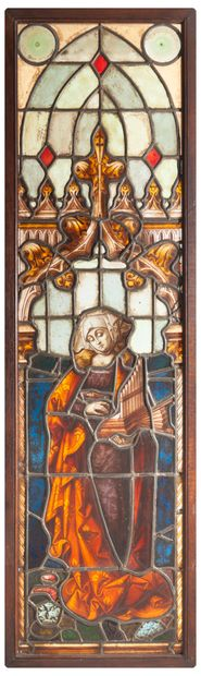 Stained glass window showing Saint Cecilia holding a portable organ.  In polychrome...