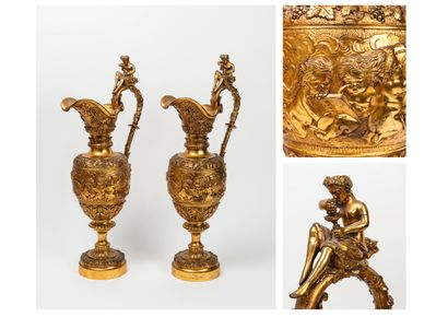 A pair of decorative ormolu ewers with ovoid...
