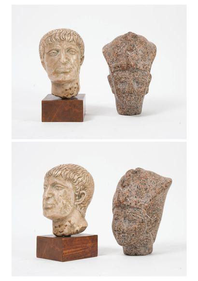 Deux têtes sculptées en pierre, dans le goût...