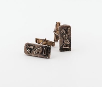 Pair of silver plated cufflinks, with a rectangular plate decorated with a hieroglyphic...