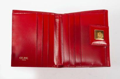 CELINE Paris, Portefeuille en box rouge, à fermoir pression sous plaque de métal...