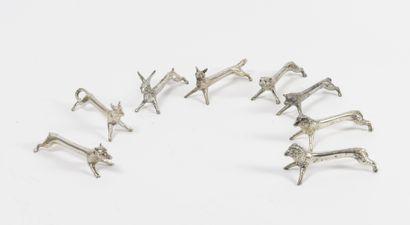 Série de 8 porte-couteaux en métal argenté...
