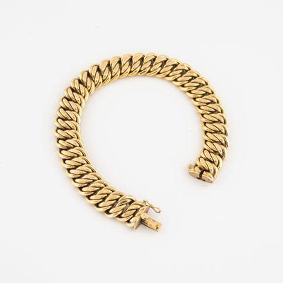 Bracelet gourmette en or jaune (750) à maille...