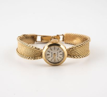 NIVADA Ladies' wristwatch in yellow gold (750)  Round case.  Dial with satin-brushed...