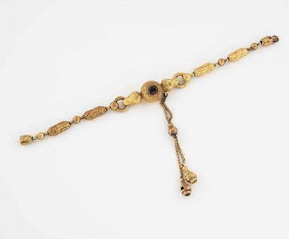 Bracelet articulé en or jaune (750) formé...