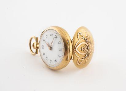 Montre de col en or jaune (750)  Couvercle arrière à décor de rubans ponctués de...