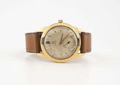 OMEGA Montre bracelet d'homme.  Boîtier rond en or jaune (750).  Cadran à fond cuivré,...