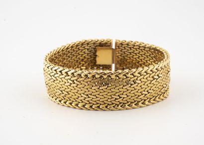 Bracelet ruban articulé en or jaune (750)...