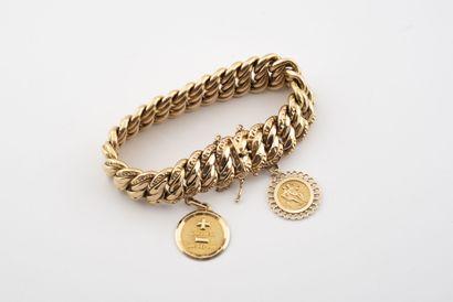 Bracelet en or jaune (750) à maille américaine...