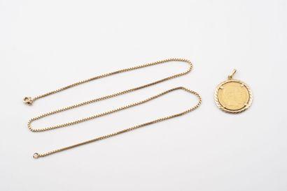 Pendentif en or jaune (750) ornée d'une pièce...