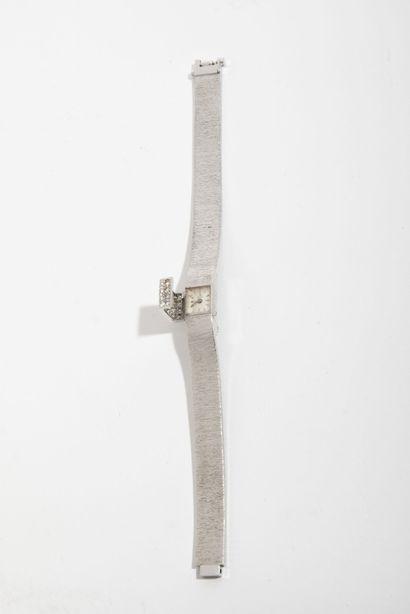 UTI Petite montre bracelet de femme en or gris (750).  Boîtier carré.  Cadran fond...