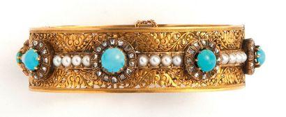 Bracelet jonc plat en or jaune (750) à décor...