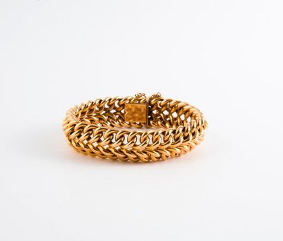 Bracelet gourmette en or jaune (750).  Fermoir...