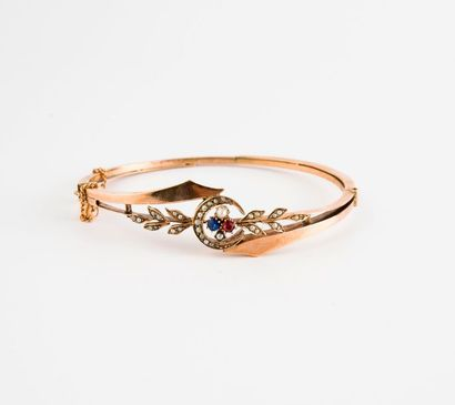 Bracelet jonc ouvrant en or (375) centré...