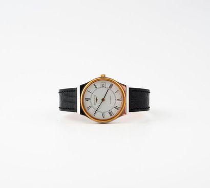 LONGINES  Montre bracelet d'homme.  Boîtier rond en acier, la lunette en métal dorée....