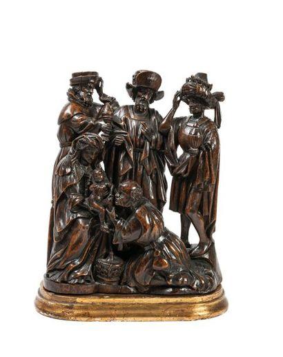 L'Adoration des mages. La Vierge assise,...