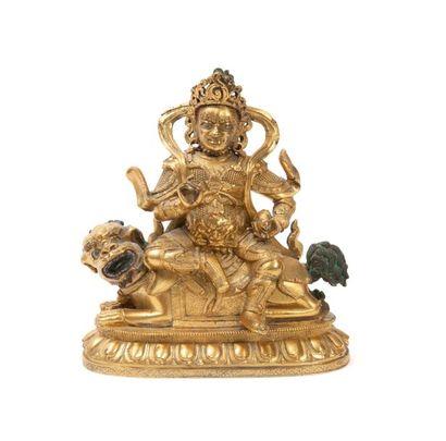 TIBET - XVIIIème siècle Statuette en bronze doré de jambhala assis en sukhasana sur...