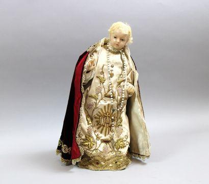 Statuette d'Eglise en cire (une jambe accidentée)...