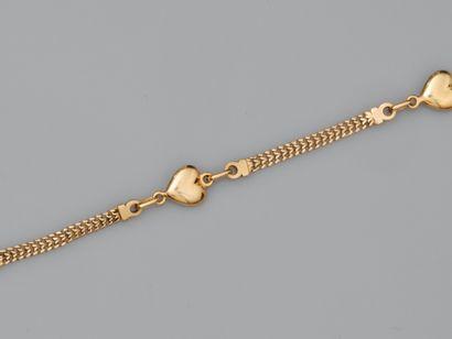Bracelet en or jaune 750°/°° (18K), orné...