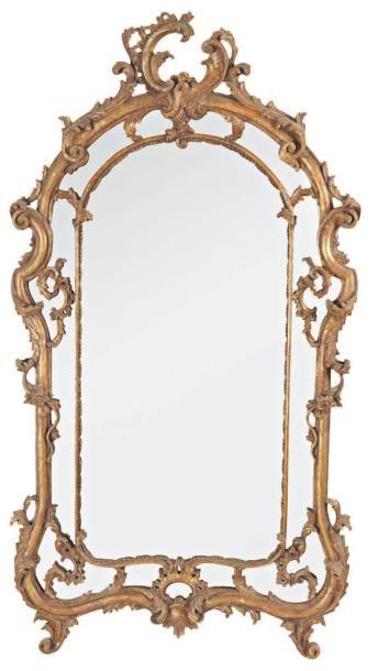 Miroir à double encadrement en bois partiellement...