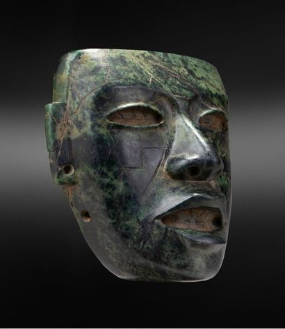 Cult mask presenting a face with a beautiful hieratic expression and a formalist...