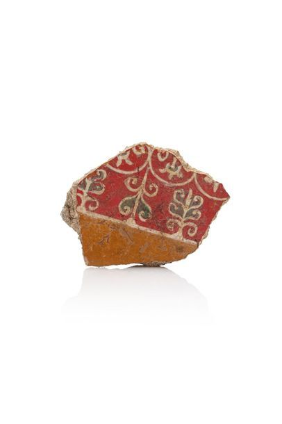 Fragment of a fresco representing a red and a yellow band decorated with palmettes...