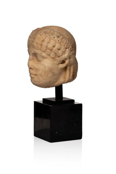 Female head with five layers of curls gathered in a band around the forehead and...