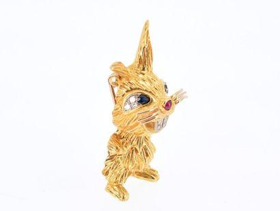 KUTCHINSKY Broche en or jaune 18k (750 millièmes) figurant un lapin joyeux, orné...