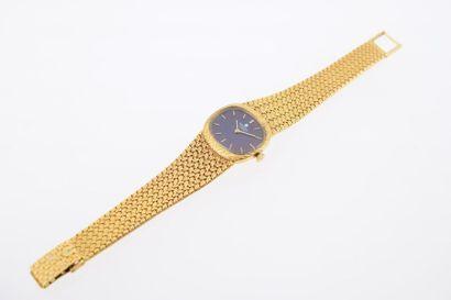 *UNIVERSAL GENEVE Montre pour dame en or jaune 18 k (750 millèmes) sur bracelet...