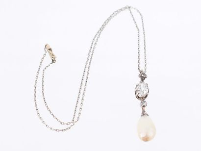 Collier composé d'une chaine et d'un pendentif en or 14k (585 millièmes) et argent...