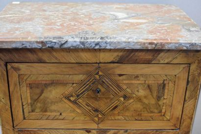 Small sideboard in light wood veneer opening with two drawers in fronts separated...