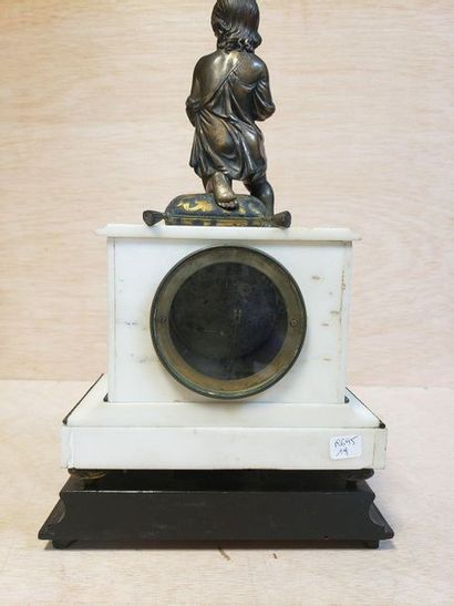 White marble clock resting on four bronze spinning legs, it is surmounted by a child...