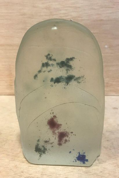 XXth  Paperweight made of thick opaque glass  Abstract relief on the front and trace...