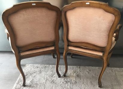 Pair of armchairs with straight backs in gendarme hats, curved and ribbed armrests...