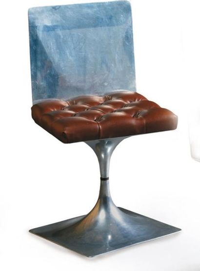 Roger TALLON Chaise pivotante en métal poli...