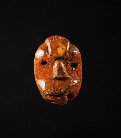 Amulette destinée à être cousue sur un «...