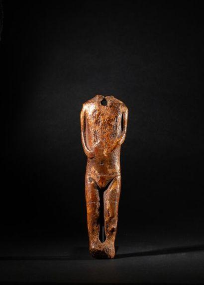 Statuette acéphale présentant des formes...