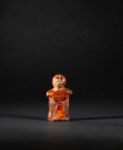 Figurine présentant un personnage debout,...