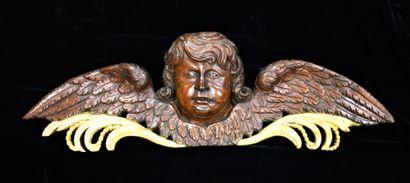 Large carved oak pediment, partly gilded,...