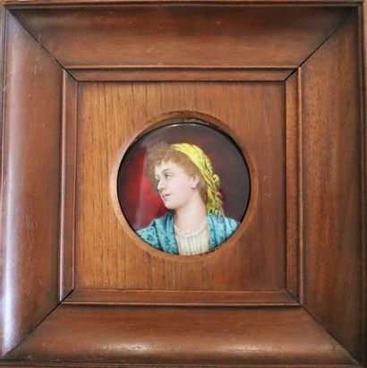 Medallion depicting a woman with a yellow...