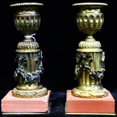 Two candlesticks in gilt bronze and patinated...
