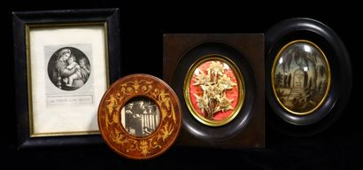 Set of two medallions of flowers under glass,...