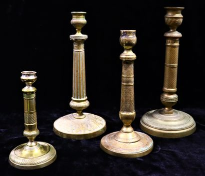 Set of four brass torches with circular base...