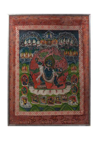 Tibet, XIXe siècle Tangka à la détrempe sur coton Représentant mahakala.  Encadrée...