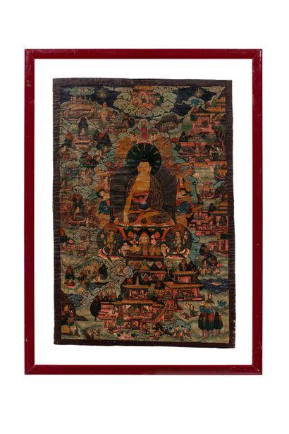 TIBET, XXe siècle Tangka à la détrempe sur coton Représentant le bouddha en partie...