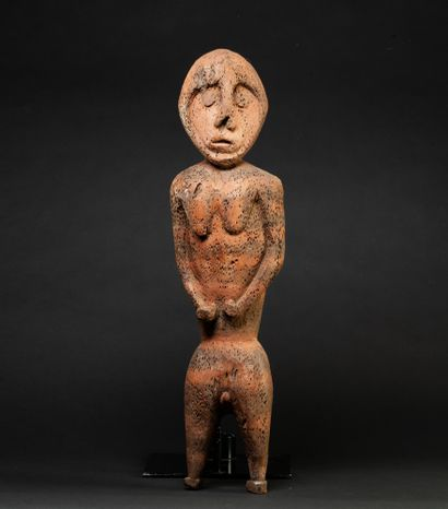 Female figure presented standing, hands placed...