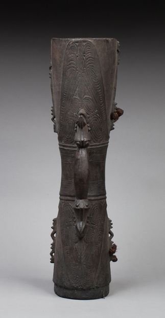 Sand drum  Each end is carved with an open crocodile mouth. The handle is adorned...
